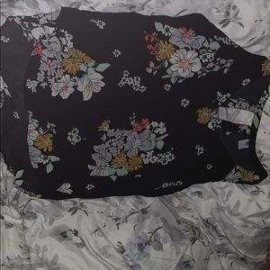 Floral tank top , with oval shaped open back.